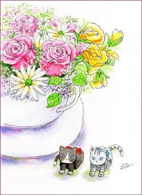 ネコの置物とお花